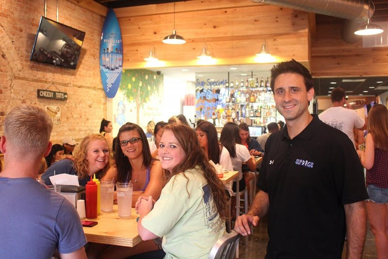 WhenSup Dogs on Franklin Street opened, owner Bret Oliverio welcomed new patrons as they came in the door.