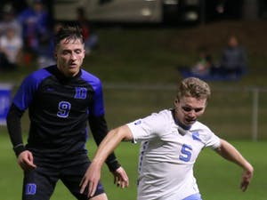Sophomore midfielder John Nelson (5) dribbles down the line during the semifinals of the ACC Championship. UNC men's soccer beat Duke 2-1.