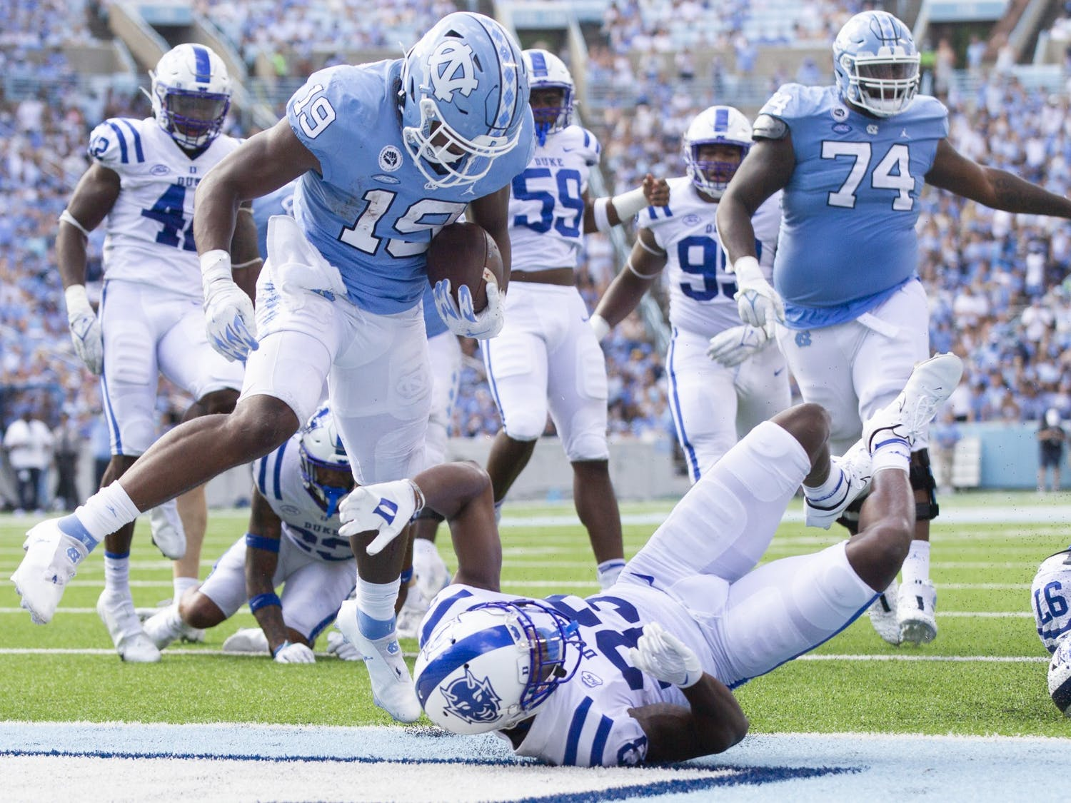 Graduate running back Ty Chandler (19) enters the end zone and brings the Tar Heels lead over Duke to 31-7. The Tar Heels defeated Duke 38-7 in Kenan Memorial Stadium on Oct. 2, 2021.