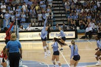 Raleigh Clark, redshirt first-year and middle hitter for the Tar Heels' women's volleyball team, hits the ball back to other side of the court in a game against N.C. State on Wednesday, Sept. 26, 2018.