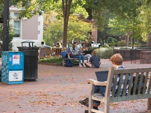 Students sit by the Campus Y on Thursday, Oct. 31, 2019. Students may be unaware of the looming possibility of a recession, potentially affecting their future job opportunities.