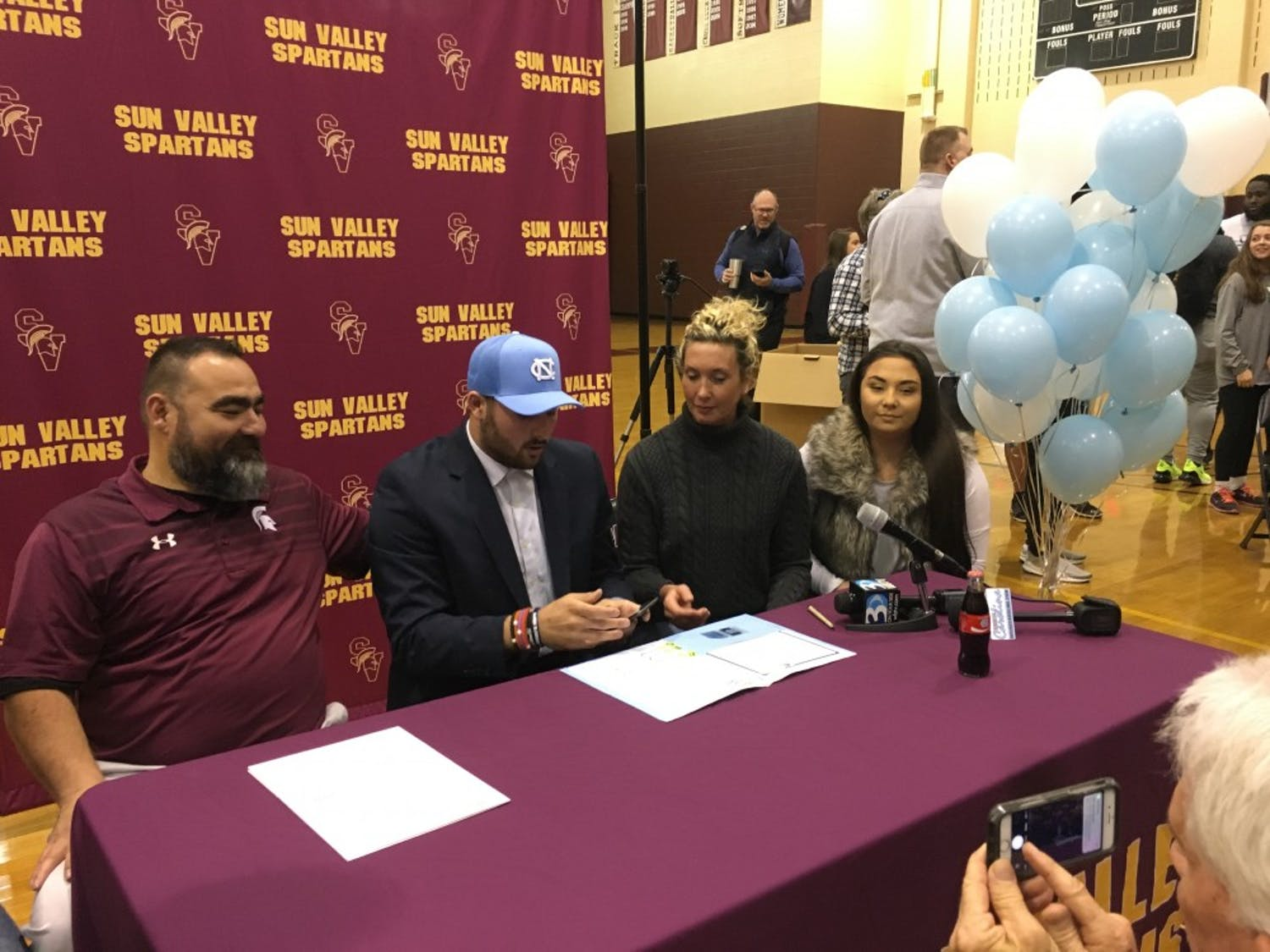 Sun Valley quarterback Sam Howell signs his national letter of intent to attend UNC while his family watches in Monroe.