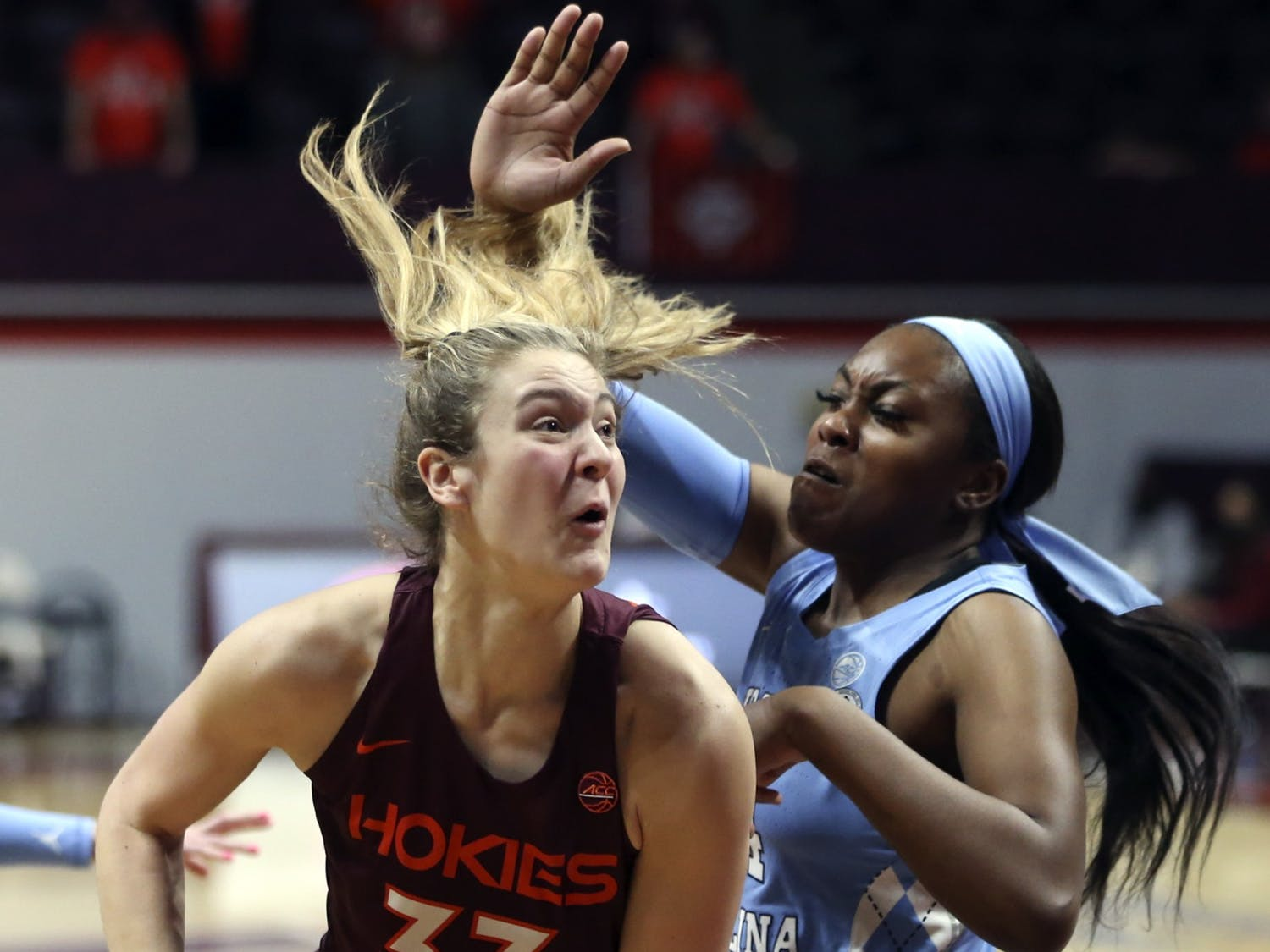 Virginia Tech's Elizabeth Kitley (33), drives on North Carolina's Janelle Bailey (44) during the first half of an NCAA college basketball game in Blacksburg Va. Sunday February 28 2021. Photo courtesy of Matt Gentry/AP Photo/The Roanoke Times