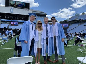 Owen Scrudders, Madison McClellan, Markus Haig, and Kevin Barth pose for a photo at their commencement ceremony in Chapel Hill on Saturday May 15, 2021. Photo courtesy of Civitella Witzke.