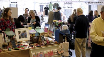 People gather at The United Church of Chapel Hill for the Alternative Market. The market was originally located on Cameron Street.