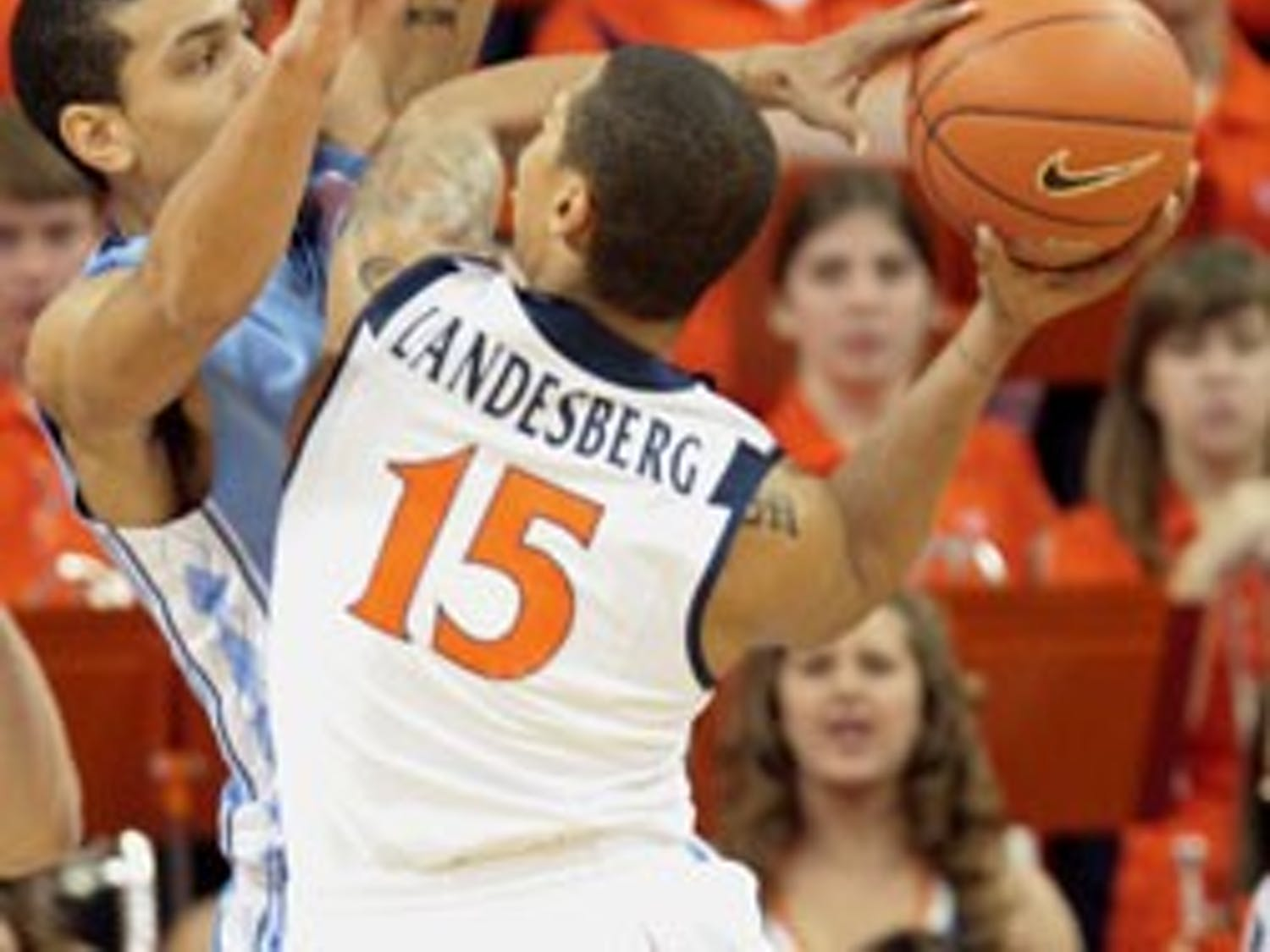 """UNC senior Danny Green defends against Virginia?s star freshman guard Sylven Landesberg"""" who ended the night with two points in 27 minutes."""