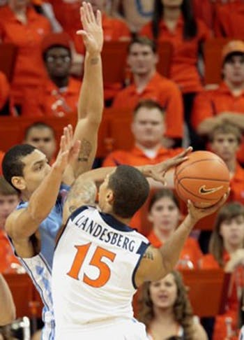 "UNC senior Danny Green defends against Virginia?s star freshman guard Sylven Landesberg"" who ended the night with two points in 27 minutes."