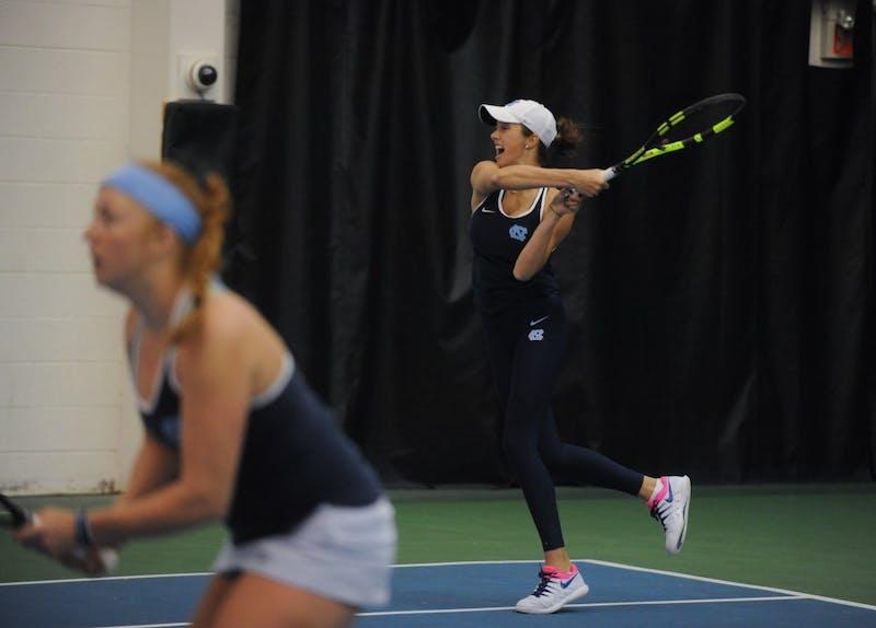 UNC women's tennis freshamn Cameron Morra returns in a doubles match alongside Sara Daavettila against Florida State University at Cone-Kenfield Tennis Center on Friday, Apr. 5, 2019. The No. 2 UNC women's tennis team beat No. 13 FSU 4-0.