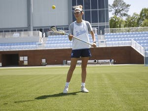 UNC women's lacrosse junior Katie Hoeg (8) stands in the new lacrosse/soccer stadium on Thursday, April 18, 2019. Hoeg has been playing lacrosse since she was in second grade.