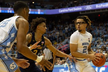 UNC guard Cole Anthony (2) makes a pass on Wednesday, Nov. 6, 2019 at the Smith Center. UNC beat Notre Dame 76-65.