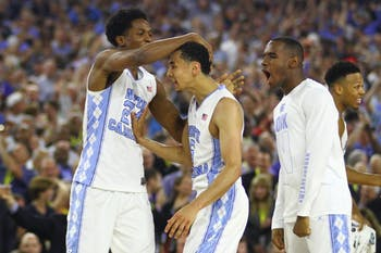 Kenny Williams (left) congratulates Marcus Paige after making a three-point shot in the last five seconds of the game.