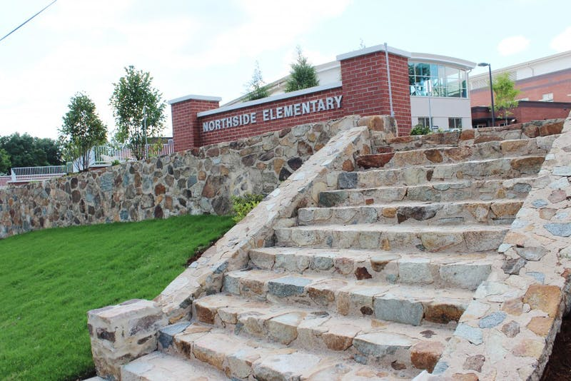 Architects at the new Northside Elementary preserved the original school's stone wall and steps.