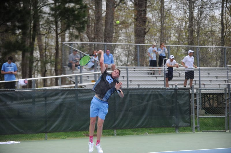 Senior Blaine Boyden serves the ball during a match against Notre Dame on Sunday, April 7, 2019. UNC won 5-0.