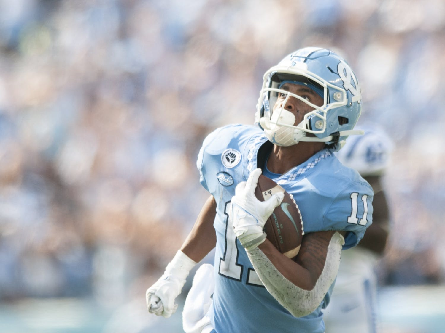 Sophomore wide receiver Josh Downs (11) scores a touchdown after receiving 63-yard pass from quarterback Sam Howell (7). The Tar Heels defeated Duke 38-7 in Kenan Memorial Stadium on Oct. 2, 2021.