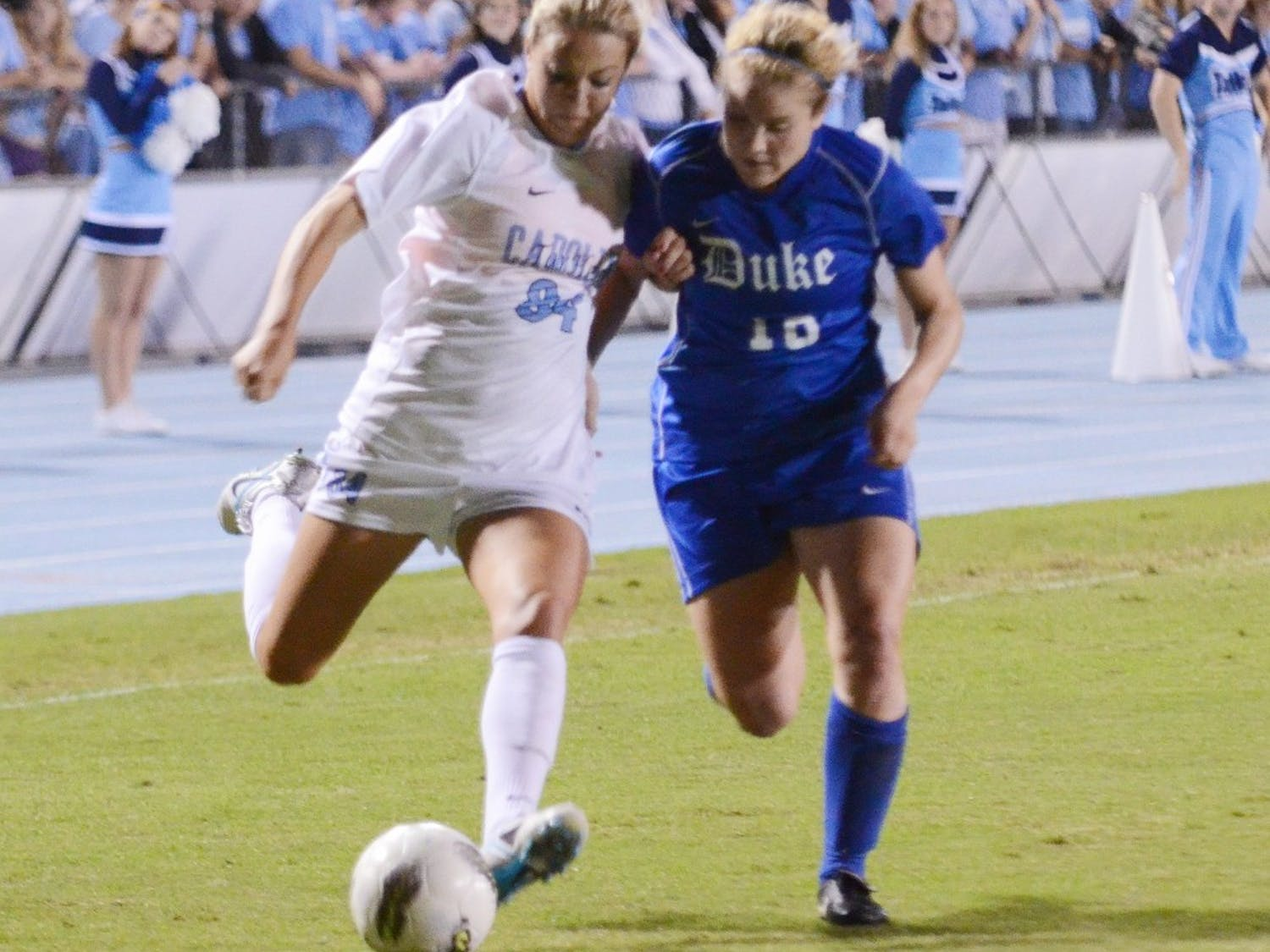 Courtney Jones fights off a Duke defender as she dribbles the ball in North Carolina's match with Duke. The Tar Heels beat the Blue Devils 1-0.