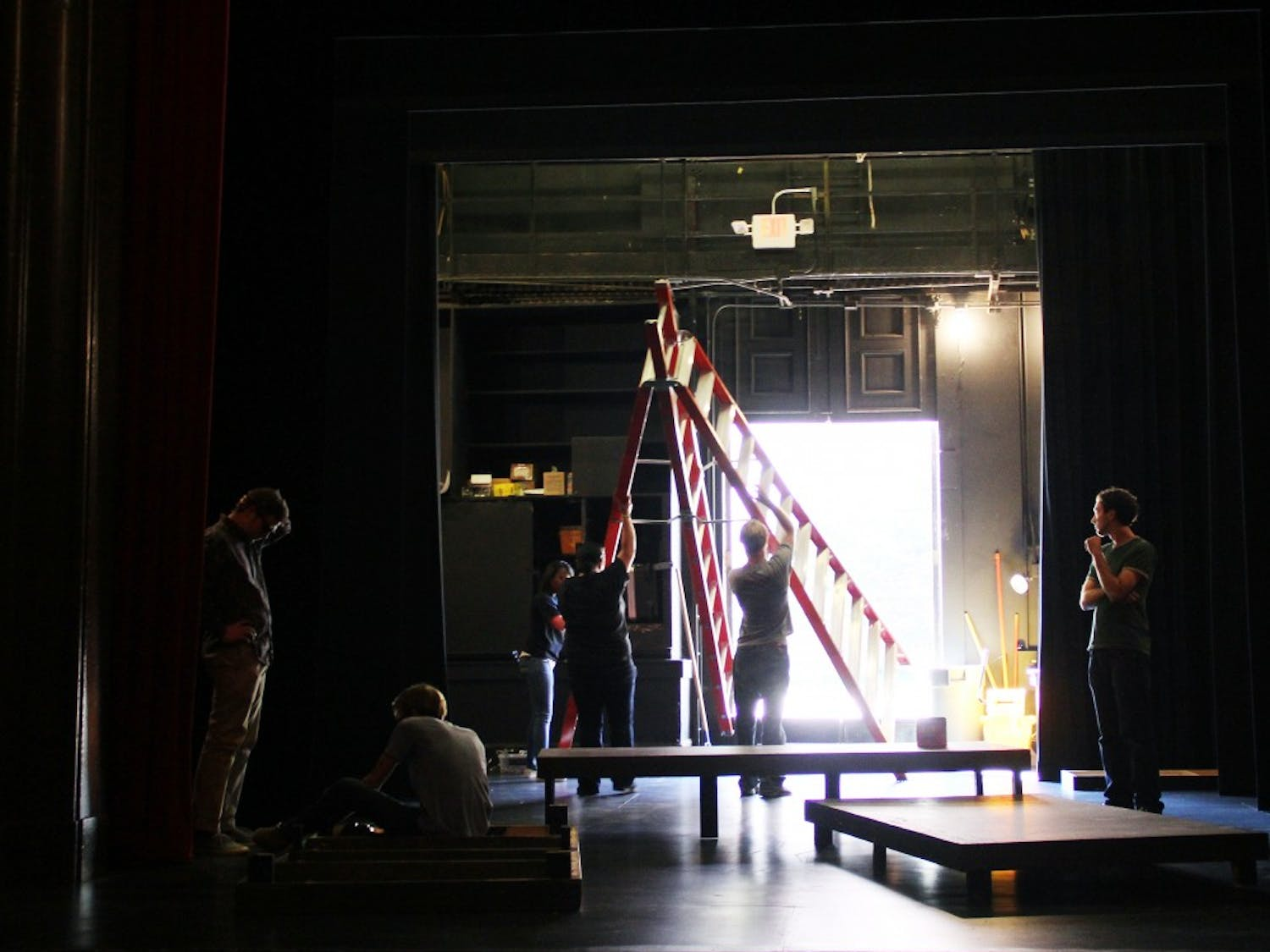 Members of the production staff help assemble pieces of the set for Doubt.