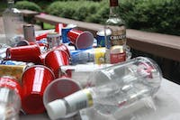 Alcohol bottles and cans litter a table after a birthday party in Chapel Hill in August 2018.