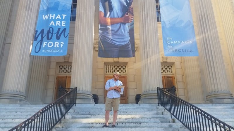 Brian Fields, a senior Political Science major, is involved in local politics and often volunteers to help students register to vote in Chapel Hill, NC.