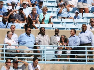 First black students John Lewis Brandon and Ralph and LeRoy Frasier were honored at Saturday's football game for the 55th anniversary of desegregation at UNC by Chancellor Holden Thorp and Vice Chancellor Winston Crisp.