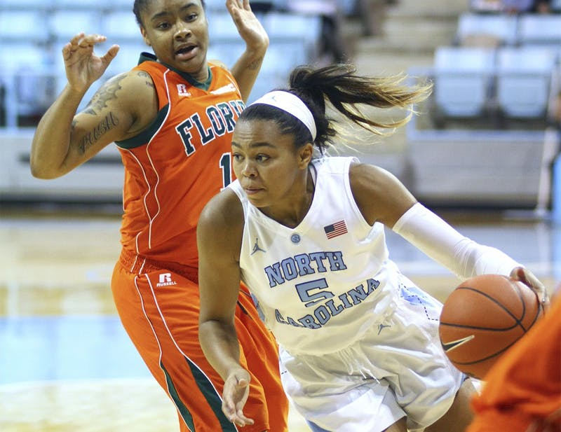 Fr. Stephanie Watts (5) battles an opponent for the ball. The women's basketball team beat Florida A&M 94-58 Tuesday night, Nov. 17.