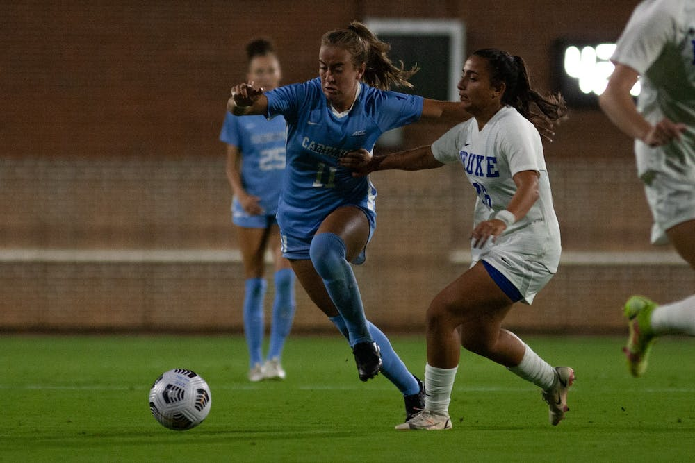 First-year midfielder Lauren Wrigley (11) runs after the ball at the game against Duke at Dorrance Field on Sept. 17. UNC lost 1-0.