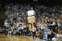 UNC senior guard Kenny Williams jumps in the air during the first half against Duke on senior night at the Smith Center on March 9, 2019.
