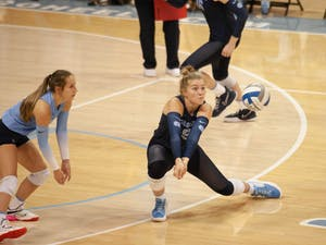 First-year outside hitter Mabrey Shaffmaster (9) saves the ball in the UNC Women's volleyball game against Virginia Tech at the Woolen Gymnasium on Oct. 10. The Heels won 3-0.