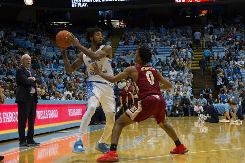 Sophomore guard Leaky Black passes ball to another player in basketball game against Elon University on Thursday, Nov. 20, 2019. UNC won 75-61.