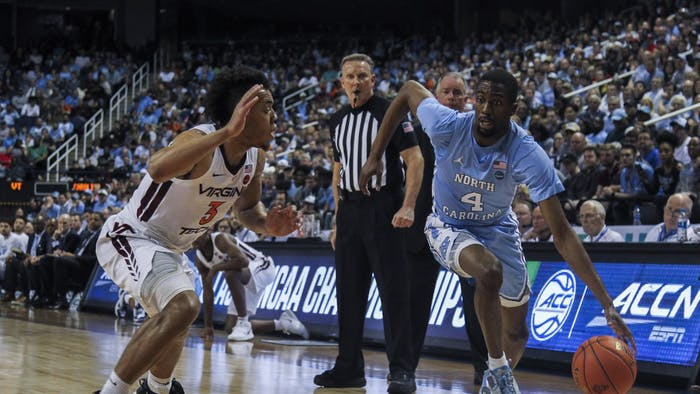 Senior guard Brandon Robinson (4) dribbles during the first-round game of the ACC tournament against Virginia Tech in the Greensboro Coliseum Complex on Tuesday, March 10, 2020. UNC beat Virginia Tech 78-56.
