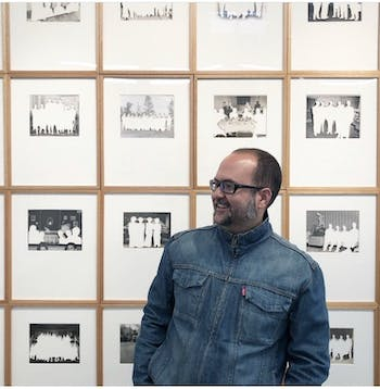 Alejandro Cartagena in front of his work. Photo courtesy of Alejandro Cartagena.