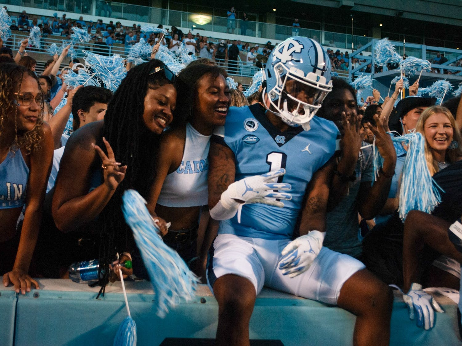 UNC sophomore wide receiver Khafre Brown (1) poses with fans before the Tar Heels start their home game against the University of Virginia. UNC defeated the Cavaliers 59-39, their second win of the season.