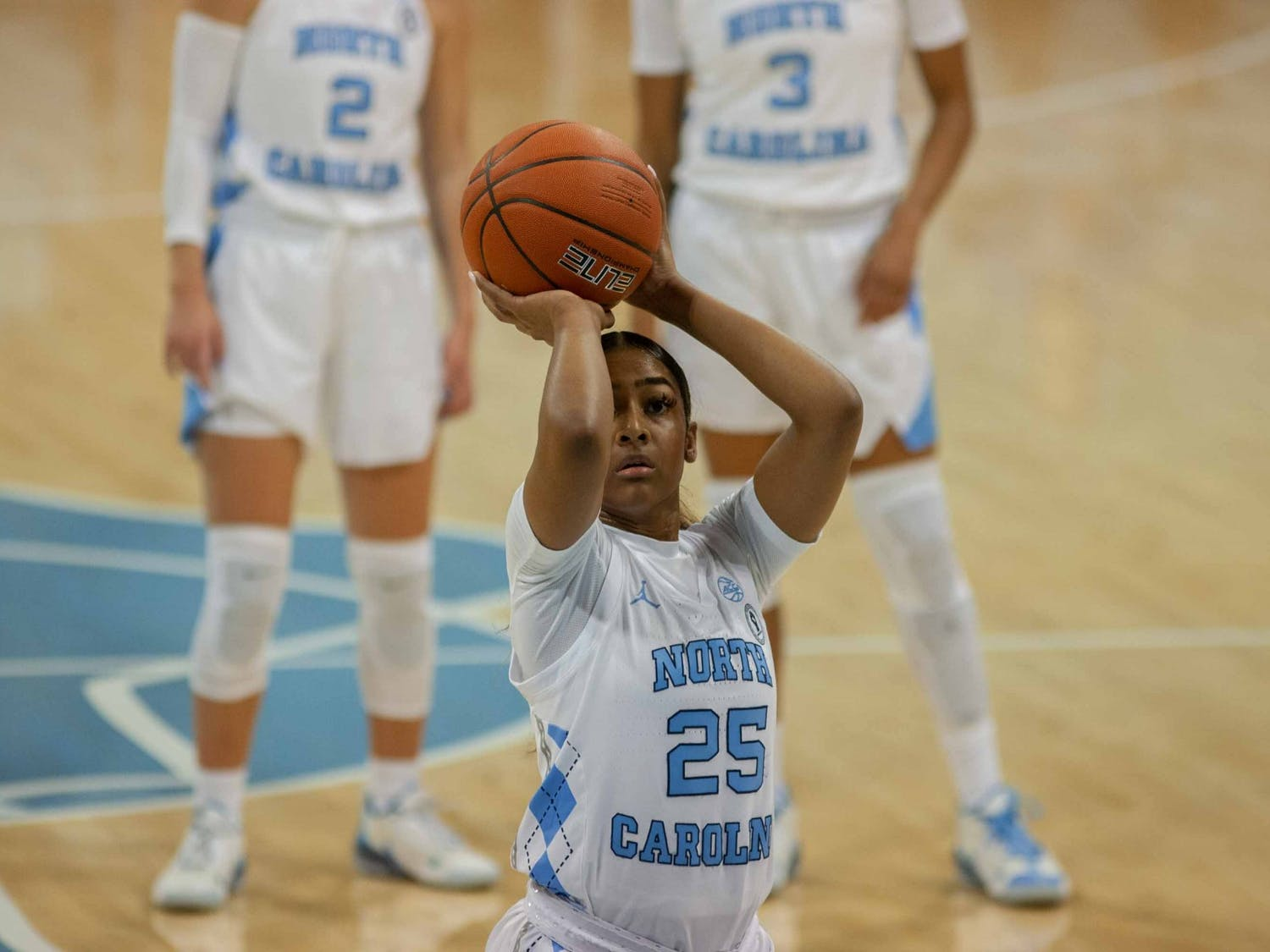 First year guard Deja Kelly (25) prepares to make a free throw during the game against Syracuse in Carmichael Arena on Thursday, Dec. 17, 2020. UNC beat Syracuse 92-68.