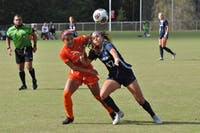 Midfielder Alex Kimball (47) fights for a ball against Virginia Tech defender Jaylyn Thompson (3) in the ACC Tournament quarterfinals on Oct. 28 at WakeMed Soccer Park in Cary. UNC defeated Virginia Tech 2-0 to advance to the semifinals.