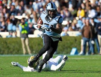 Kendrick Singleton (81) breaks a Pittsburgh tackle and looks upfield.