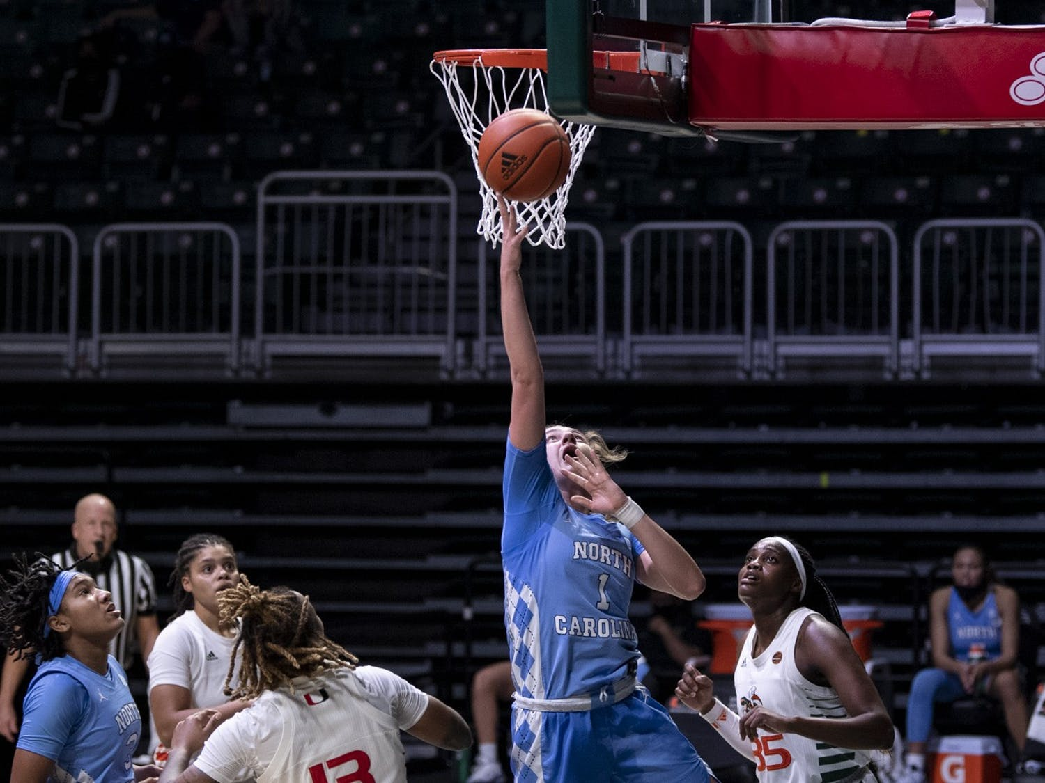 UNC first year guard Alyssa Utsby (1) attempts a layup during a game against The Miami Hurricanes at Watsco Center on December 14, 2020 in Coral Gables, FL. Photo by Kevin Ortiz/University of Miami Athletics