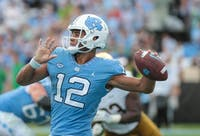 Quarterback Chazz Surratt (12) rears back for a pass during a game against Notre Dame on Oct. 7 in Kenan Memorial Stadium.