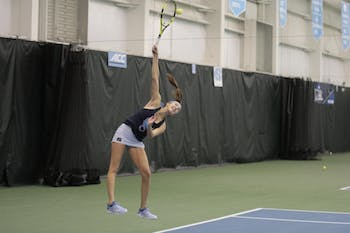 Fist-year Cameron Morra serves during a singles match against East Carolina University at the Cone-Kenfield Tennis Center in Chapel Hill, NC on Wednesday, Jan. 23, 2019. Morra won both sets in the match.