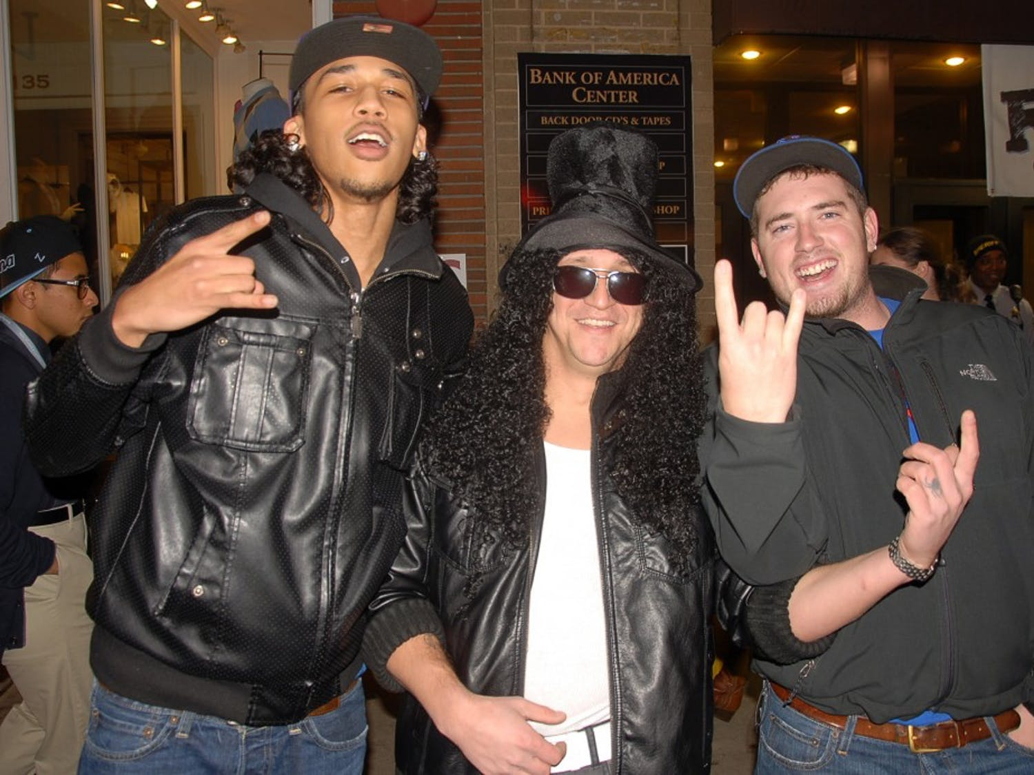 """Brian Gourly, center, of Oxford, N.C., poses as Guns 'n Roses guitarist Slash. """"There has been a lot of horns and whistling and a lot of yelling,"""" Gourly said."""