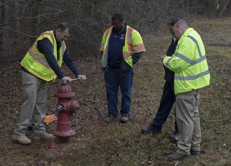 OWASA workers test a fire hydrant near the Friday Center during the water shortage.
