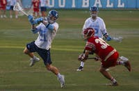 North Carolina sophomore midfielder Justin Anderson (21) fires a shot against Denver on March 5 at Kenan Stadium.