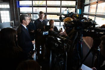 Gov. Roy Cooper (left) stands for interviews following a press conference introducing Well Dot Inc., a health technology company, to the Chapel Hill area on Tuesday, Nov. 19, 2019. Well plans to create 400 new jobs.