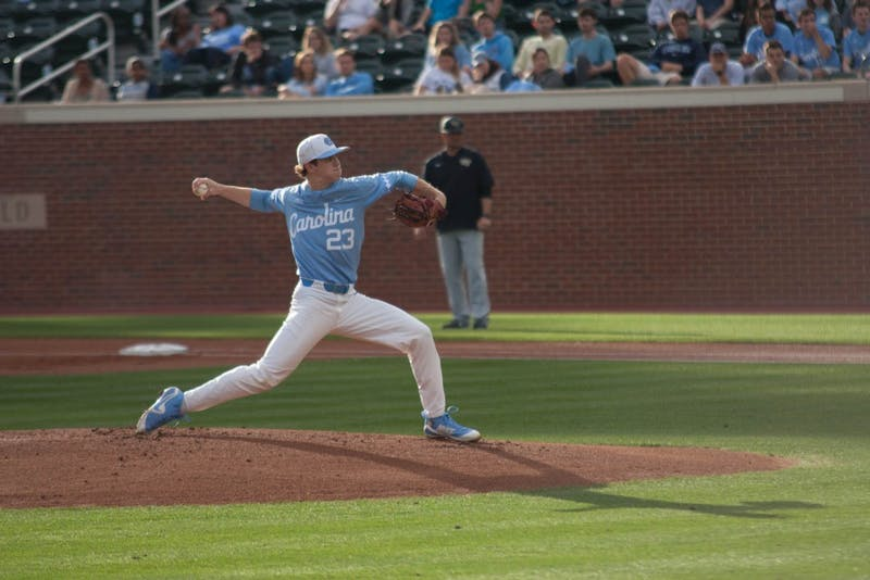 Sophomore Tyler Baum (23) pitches against Wake Forest on March 30 at Boshamer Stadium.