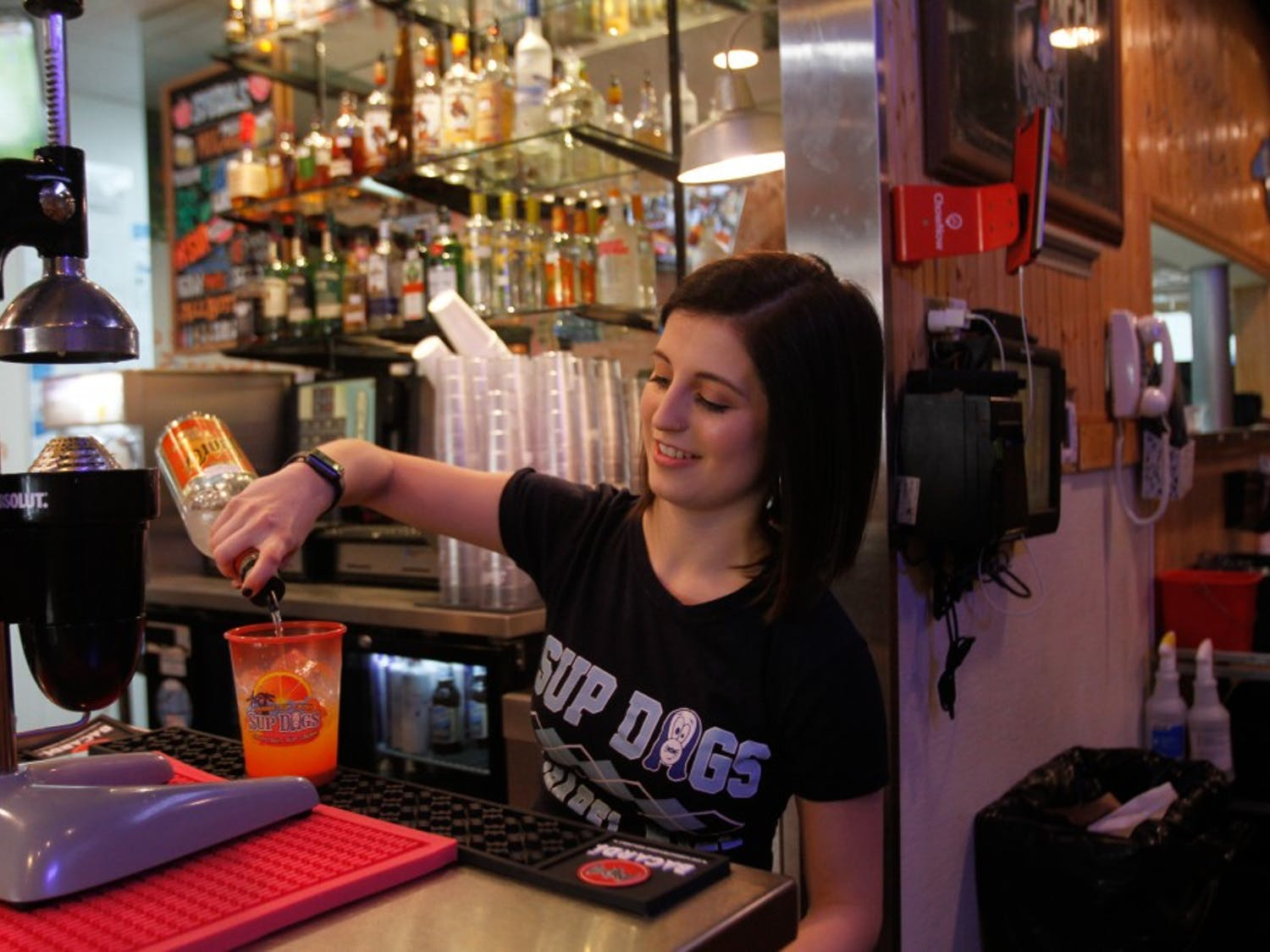 Senior reporting major Sara Pequeño works at popular Franklin Street bar, Sup Dogs, and is often recognized by her student peers while in class and at work.