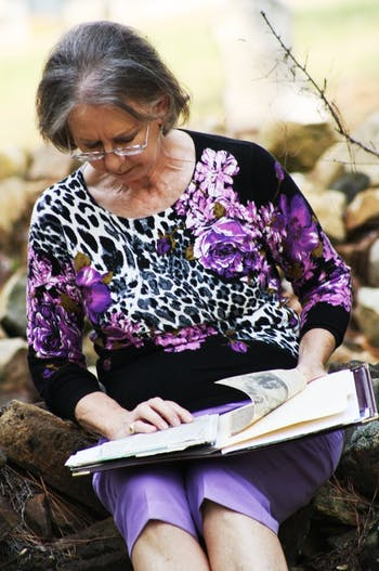 Evelyn Poole-Kober, a UNC graduate and resident of Hillsborough, N.C., sorts through old newspaper clippings and files depicting her journey in reviving the Margaret Lane Cemetery.