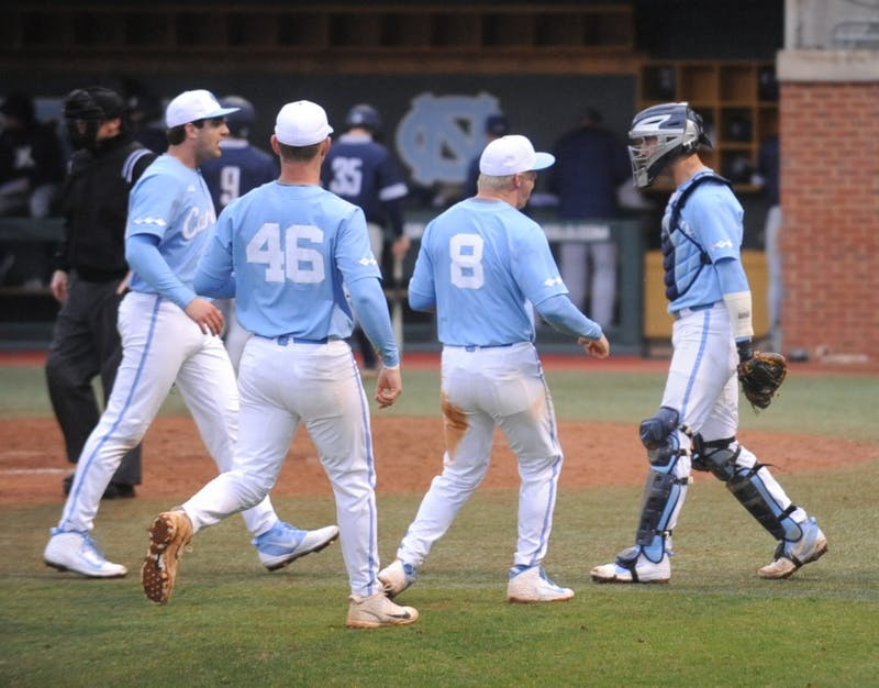 UNC baseball players celebrate during the game against Xavier in Boshamer Stadium on Sunday, Feb. 17, 2019. UNC beat Xavier 14-3.