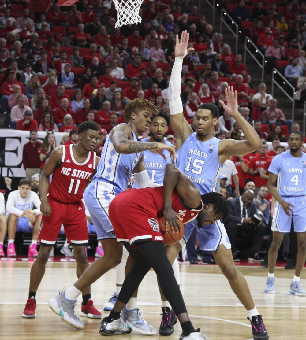 Junior forward Garrison Brooks (15) and first-year forward Armando Bacot (5) squad up against N.C. State during the game against N.C. State in PNC Arena on Monday, Jan. 27, 2020. UNC defeated N.C. State for the seventh time in a row 75-65.