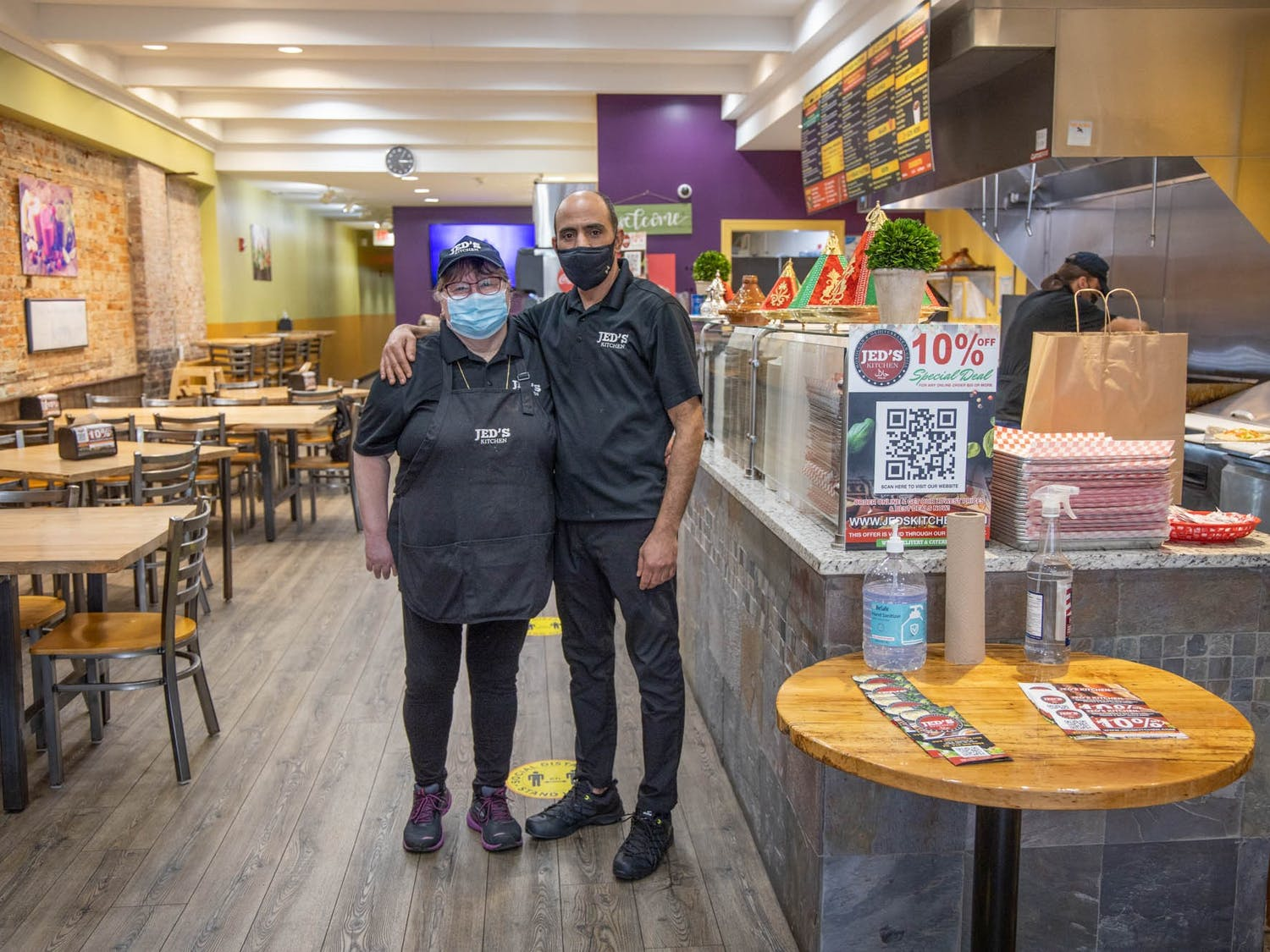 Larbi Jeddour and Cathy Starks, co-owners of Jed's Kitchen, pose for a portrait in his restaurant on Wednesday, March 3, 2021. Jeddour, who is originally from Morocco, opened the Moroccan and Mediterranean grill in December 2020.