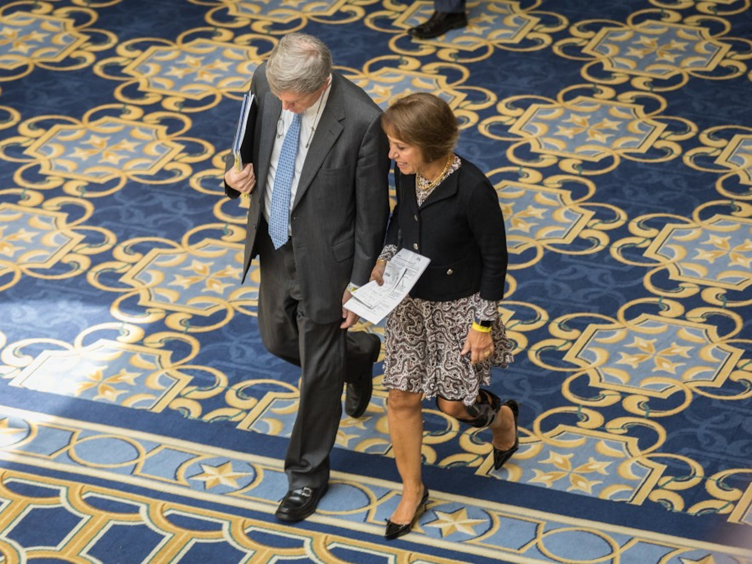 UNC Chancellor Carol Folt walks with Mark Merritt, vice chancellor and general council of UNC, through the Gaylord Opryland Resort & Conference Center in Nashville, Tenn. during a lunch break Aug. 16, 2017.