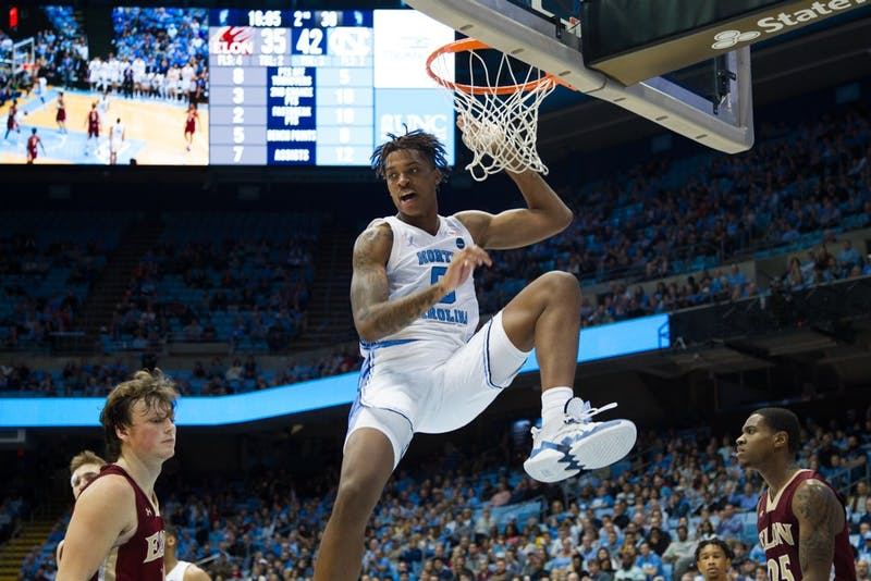 First-year forward Armando Bacot (5) pushes pass opposing players in basketball game against Elon University on Thursday, Nov. 20, 2019. UNC won 75-61.