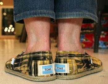 "Maggie Pearson, or ""Magoo"" of the Toots & Magoo store, wears TOMS on Tuesday afternoon while working in the store."